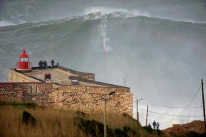 Big wave surfer Garrett McNamara surfs a 100+ foot wave at Nazare.